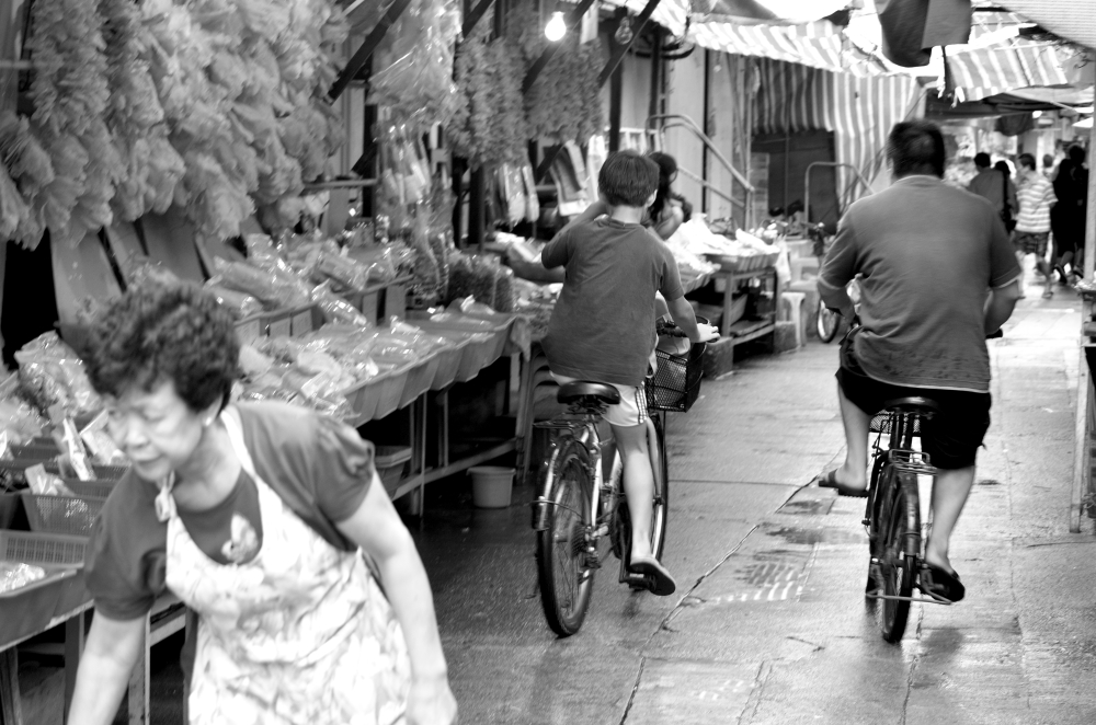Tai O street cyclist