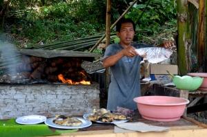 Grilling Fish with coconut flames
